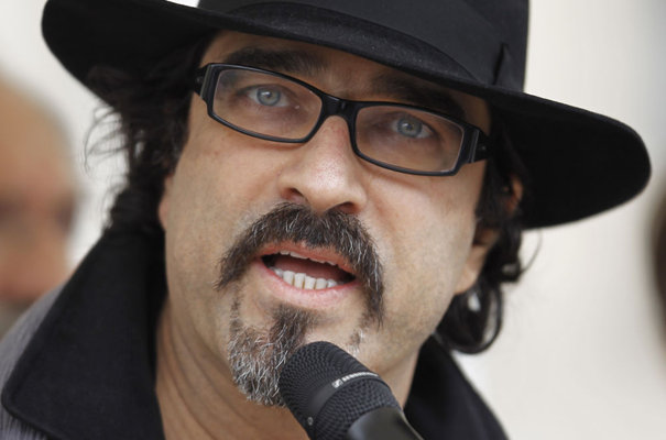 Afghan author Atiq Rahimi delivers a speech during a demonstration in Paris